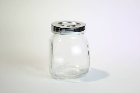 Small Transparent Glass Jar with metal lid container on white background  Stock Photo