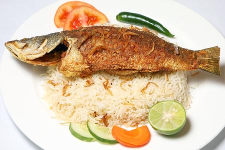 fish biryani whole grilled fried roasted spicy Stock Photo