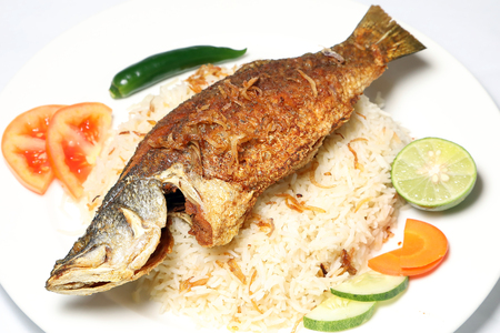 fish biryani whole grilled fried roasted spicy Stock Photo
