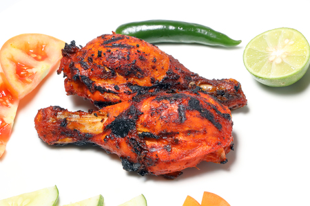 Grilled Chicken tandoori spicy hot drumsticks with salad and raita