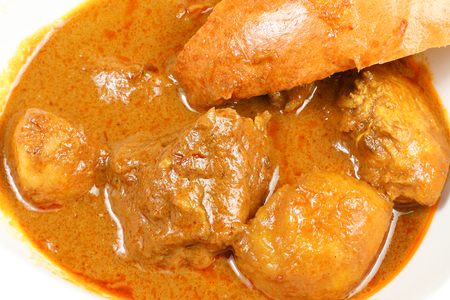 Curry whole chicken potato in steam large bun traditional Malaysia Chinese cuisine