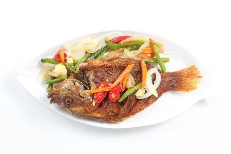 Deep fried tilapia fish whole crispy crunchy on white background   Stock Photo