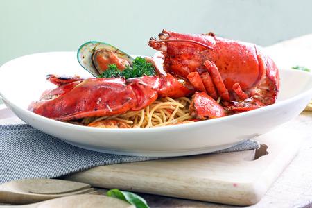 Seafood Lobster Spaghetti pasta linguini calamari clam tomato parsley  Stock Photo