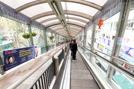 CENTRAL, HONG KONG-FEBRUARY 18, 2018 - Central Mid-Levels escalator is the longest outdoor covered escalator system in the world. It links Queens road with Conduit Road in the Mid-Levels, passing through narrow streets.