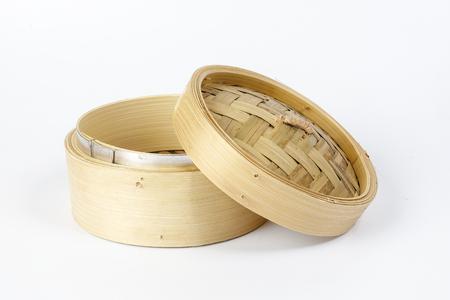 Wooden bamboo dim sum steamer on white background Reklamní fotografie