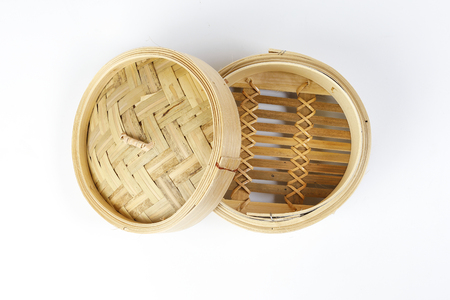 Wooden bamboo dim sum steamer on white background