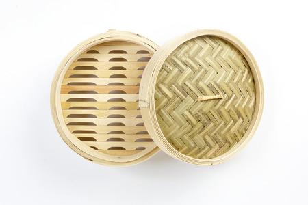 Wooden bamboo dim sum steamer on white background