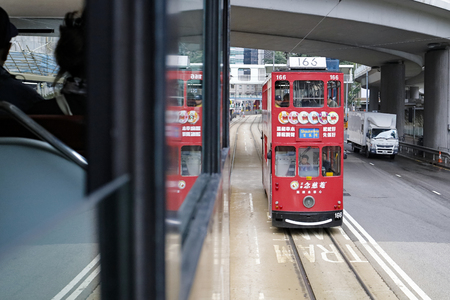 HONG KONG – March 14, 2019: Double-decker trams are a major tourist attraction and one of the most easy ways of travelling in island.