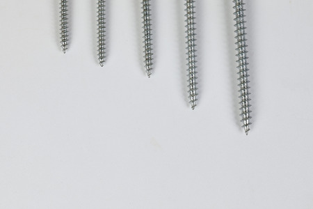 Metal screw plug on white background