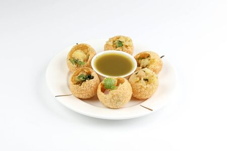 Tadeonal subcontinental street snack food chickpeas potato pani puri fuska with tamarind sauce