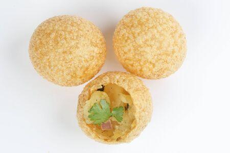 Tadeonal subcontinental street snack food chickpeas potato pani puri fuska with tamarind sauce