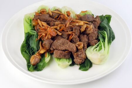 Soy ginger beef on bed of blanched bok choy
