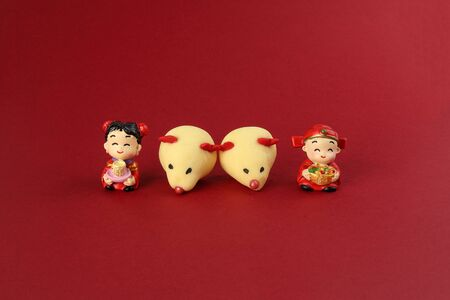 Chinese New Year rat mouse shaped cookie boy girl doll on red background