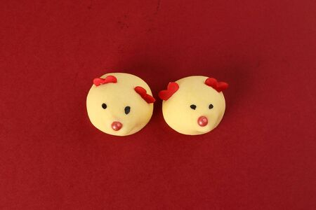 Chinese New Year rat mouse shaped cookie on red background