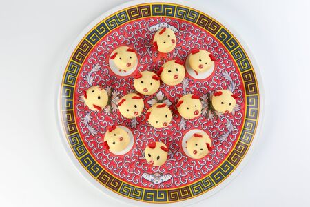 Chinese New Year rat mouse shaped cookie on decorated plate