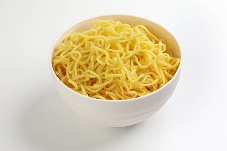 Fresh yellow egg noodle in bowl on whit background Stock fotó