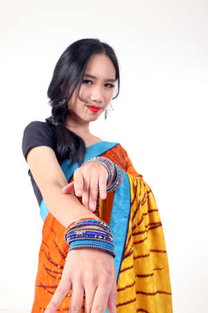 South east Asian Chinese race ethnic origin woman wearing Indian dress costume Sharee glass bangles multiracial community on white background