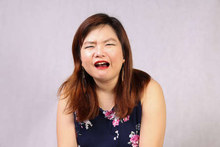 Young attractive southeast Asian woman posing facial expression cry sad