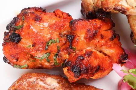 grilled chicken fish kebab lemon on white background