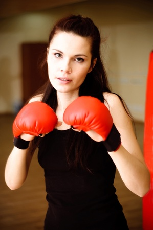 Portrait of woman in boxing-gloves.