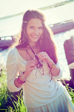 Smiling hippie girl in locking light