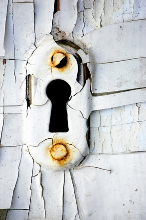 Vintage rusty keyhole with cracky white. photo