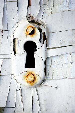 Vintage rusty keyhole with cracky white. Stock Photo - 9995547