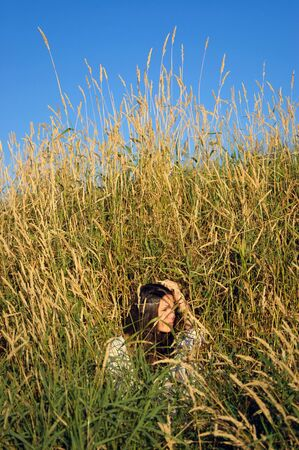 downshifting: Beautiful hippie girl in the tall grass