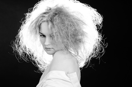 Sensual woman with fluffy hair. Black and white. Stock Photo