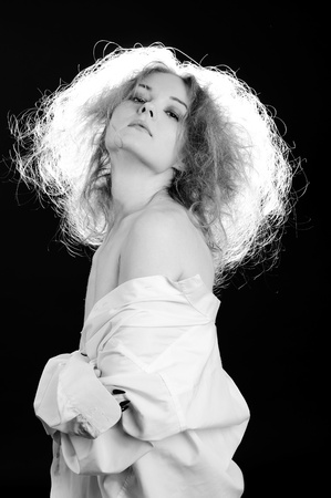 Sensual woman with fluffy hair. Black and white. photo