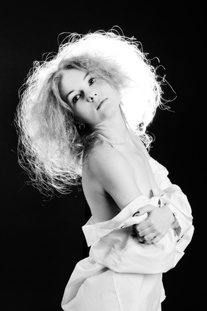 Black and white portrait of sensual woman with fluffy hair.