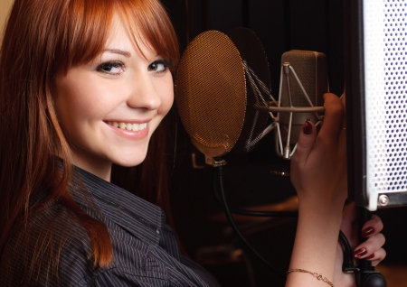 mike: Girl singing to the microphone in a studio