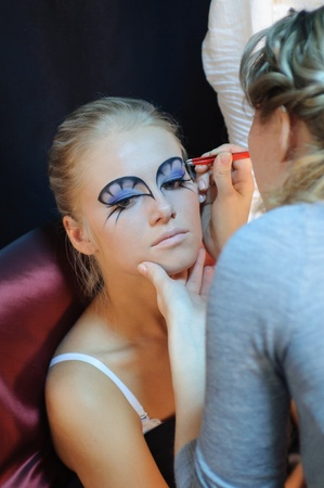 Model preparation by the visagiste before a photoshoot  photo