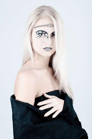 Beautiful girl with an original make up. photo