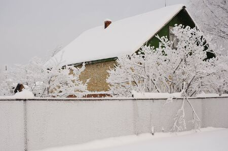 Old house in winter by the frost photo