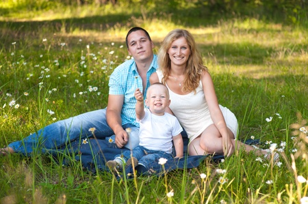 Young family recreate in park. photo