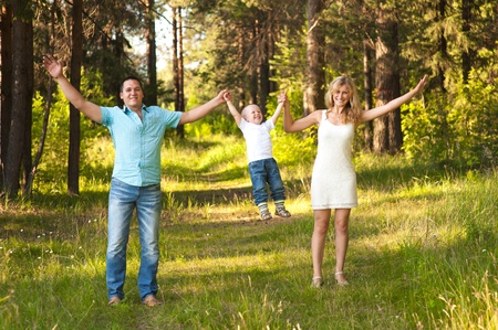 recreate: Young family recreate in park. Stock Photo