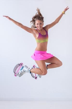 Kangoo jumps athlete makes exercises Stock Photo