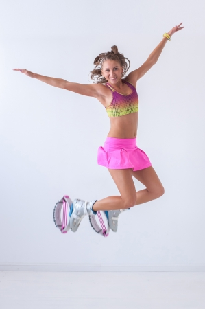 Kangoo jumps athlete makes exercises photo