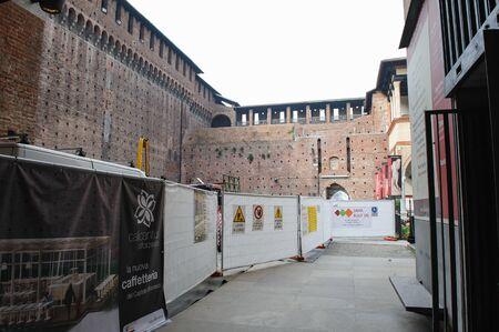 sforza: MILAN, ITALY - MARCH 19, 2015: On the streets of the city. Sforza Castle (Italian: Castello Sforzesco). Places fence restoration Editorial