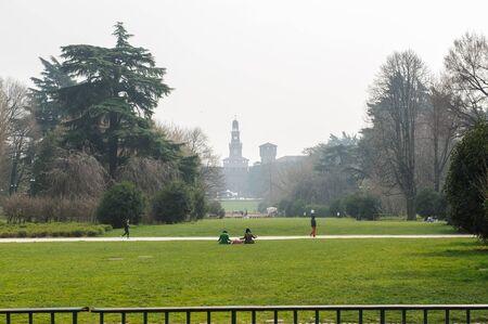 sforza: MILAN, ITALY - MARCH 19, 2015: On the streets of the city. Park with view on Sforza Castle (Italian: Castello Sforzesco)