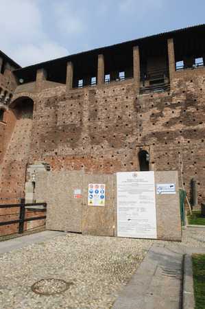 sforzesco: MILAN, ITALY - MARCH 19, 2015: On the streets of the city. Sforza Castle (Italian: Castello Sforzesco). Places fence restoration Editorial
