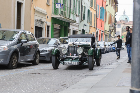 mille: BRESCIA, ITALY - MARCH 21, 2015: Retro cars on the streets of  Brescia