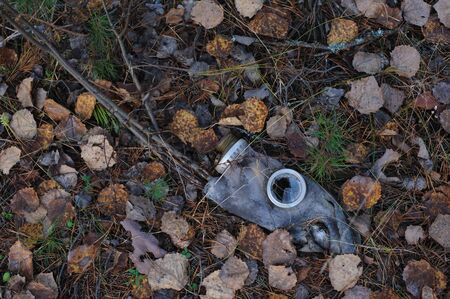 biochemical: Close up of damaged gas-mask on the ground. Stock Photo
