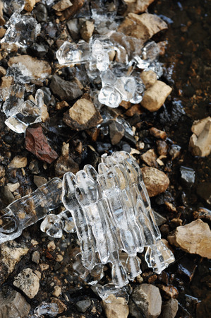 thawing: Remnants of ice on the stone banks of the river in the late spring melting. Stock Photo