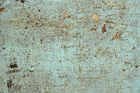 Cracked blue paint on an old wooden surface