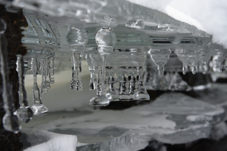 Spring melting of ice. Icicles gallery.