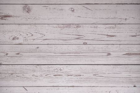 Blurred rough skin surface of an old wooden plank for background texture