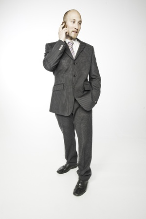 Businessman holding a conversation for Mobile phone photo
