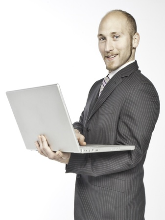 businessman working with his computer on a white background photo